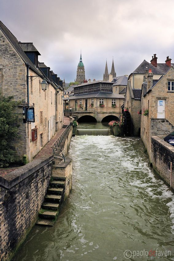 A view of downtown Bayeux ~ with its canals, stone buildings + cobblestone lanes. Bayeux is a wonderful medieval town in the heard of lower Normandy, France By Paolo De Faveri Landscape Photography