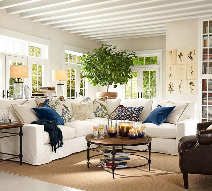 Pops Of Blue Textiles And Candles Give This All White Living Room A Fresh Look