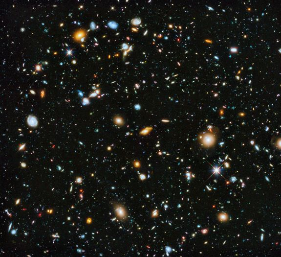 The Hubble Space Telescope accumulated approximately 555 hours of exposure time to capture this Hubble eXtreme Deep Field image. The area shown represents a seemingly empty patch of sky about the width of a toothpick when held at arm's length. The picture contains only two foreground stars (indicated by surrounding spikes). Every other object is a galaxy. The most distant galaxies' light is reddened by the expansion of the universe. We're seeing light that left them 13.2 billion years ago.