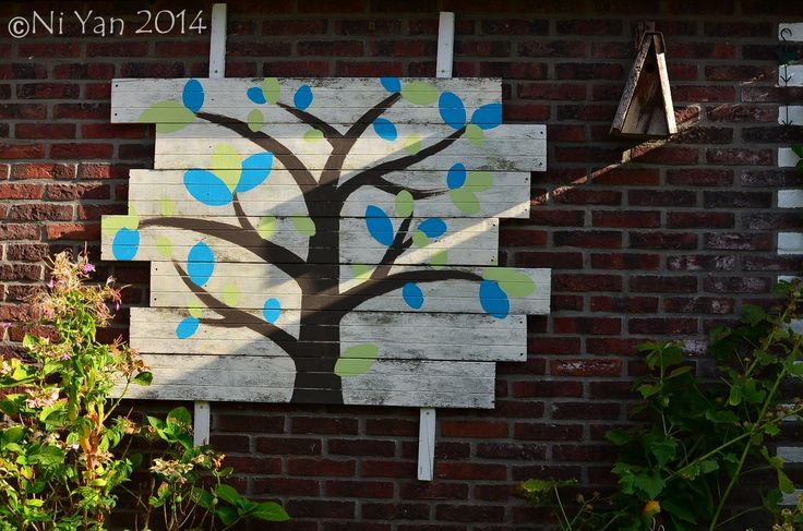 Tree of life © Ni Yan, garden art project with recycled wood and outdoor wall paint, August 2014 © Ni Yan