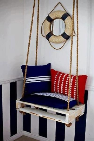 Here is yet another example of what can be done with a wooden pallet, although I haven't worked out why you would put a swing hard up against a wall. :-/