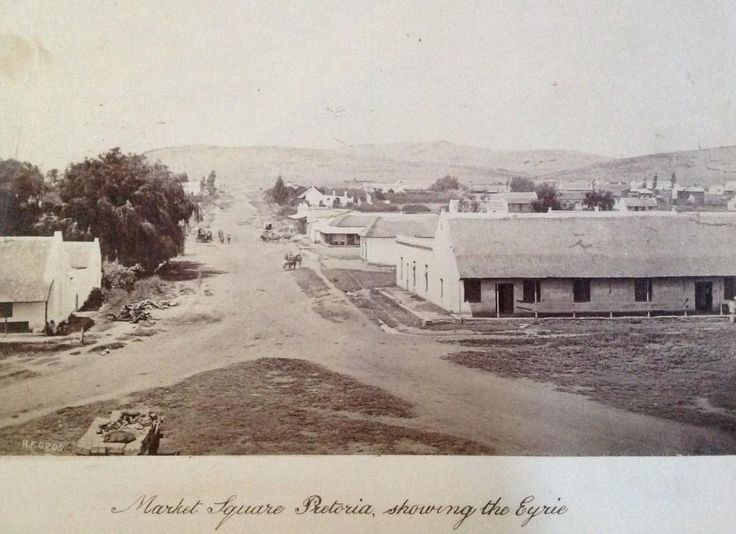 """One of the earliest recorded Pretoria photographs by Gros (Circa 1877). Taken from church tower looking south (Market street). Building on the left is John Robert Lys's home """"Eyrie""""- meaning: Inaccessible eagles nest"""