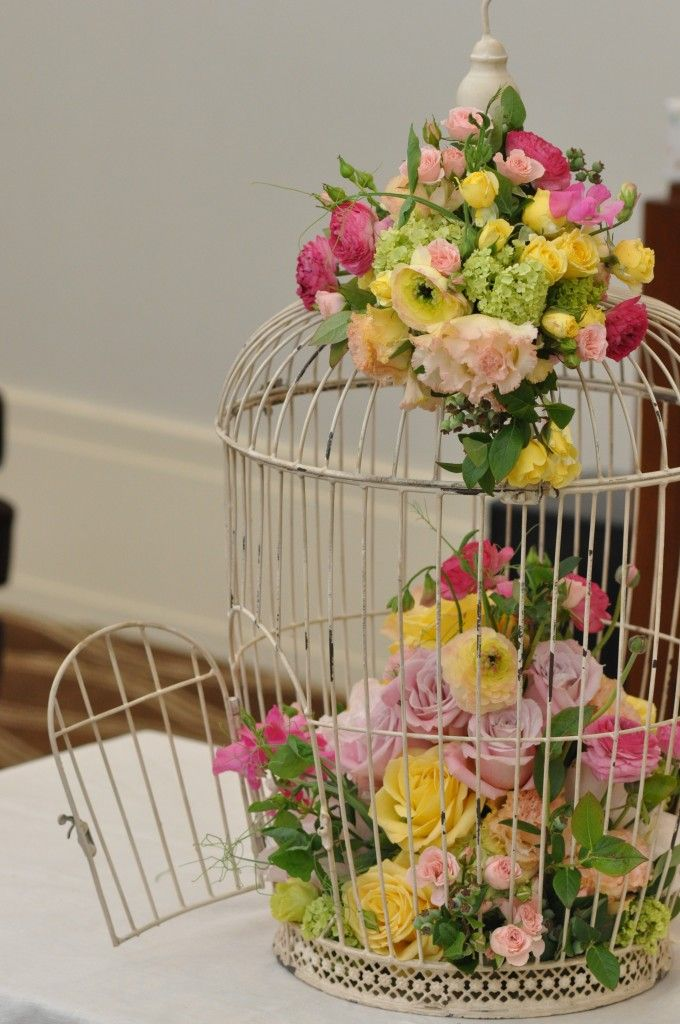 vintage birdcage just one type of flower plus pearls and a few books inside