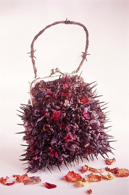 My dangerous handbag,made from steel carpet tacks ,heat treated fabric and barbed wire.Be careful what you wish for