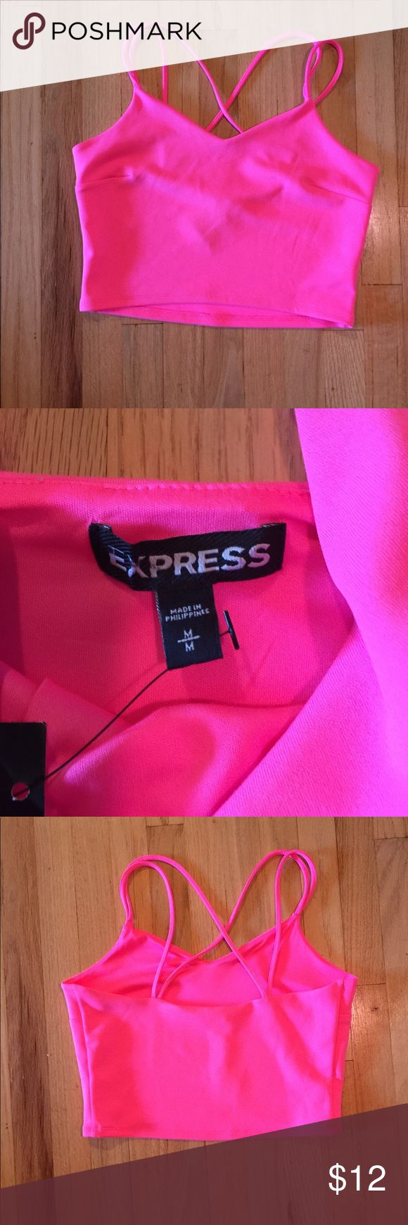 Express strappy pink crop top tank NWT A new with tags cute pink strappy cropped tank by Express. Size M. Spaghetti straps and v neckline. Poly/ spandex. Machine washable. Comfortable fabric. Tag slashed to prevent store return. Express Tops Tank Tops