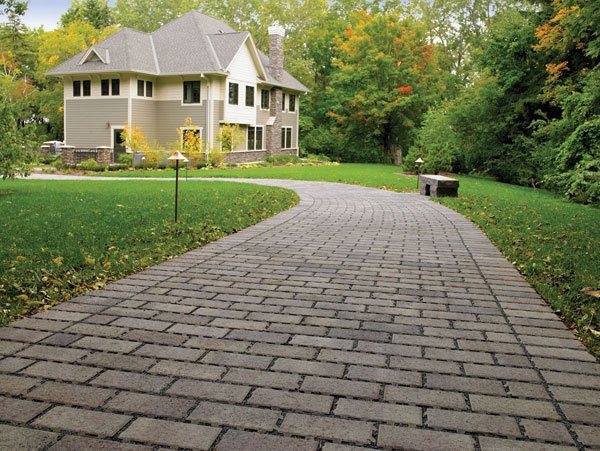 Anchor Holland Grand Permeable pavers let rain soak into the soil.