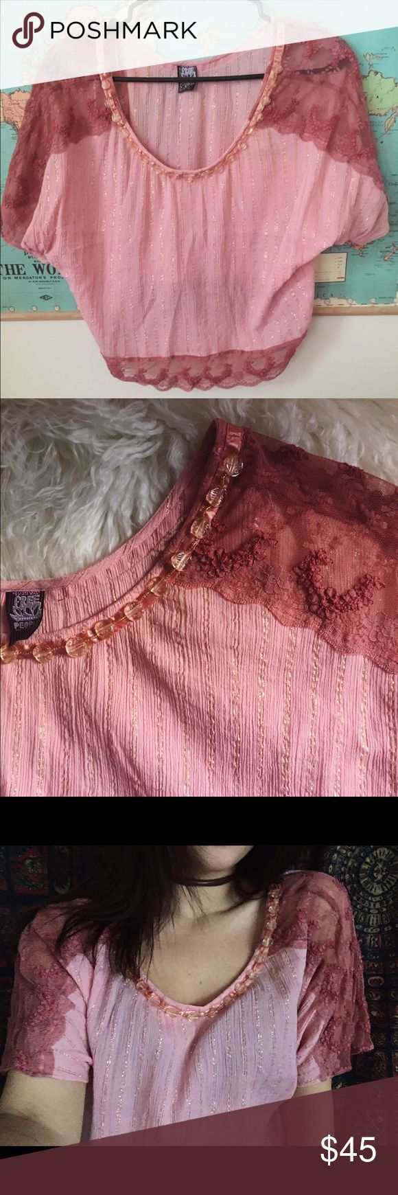 Free people Free people pink slouchy top with beaded neckline, metallic gold accents, and delicate lace details on sleeves. Only worn two or three times Free People Tops