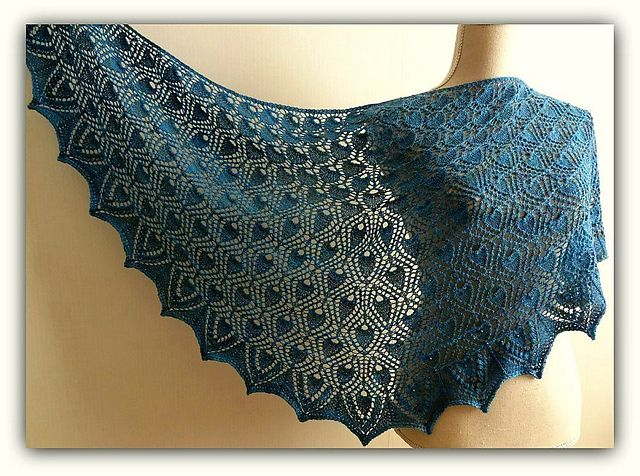 Anemone is a triangular sized shawl with eyecatching leaves. The shawl has a distinctive flowing appearance since it has no classical center line construction. The border has nupps in it to give it a defined edge. You can choose to add beads to the nupps and written instructions for this are included in the pattern.