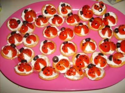 Lady Bug Appetizers - Ritz Crackers, veggie cream cheese, cherry tomatoes, and black decorators gel!
