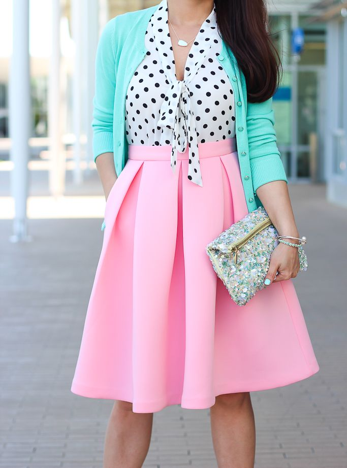 Black and white polka dot blouse with pink pastel skirt and blue pastel jacket