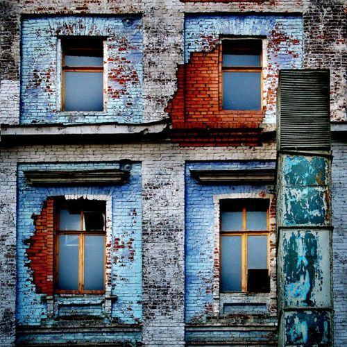 windows and a building with age. It may be a ruin. It may just be old. When looked at abstractly - it's lovely.