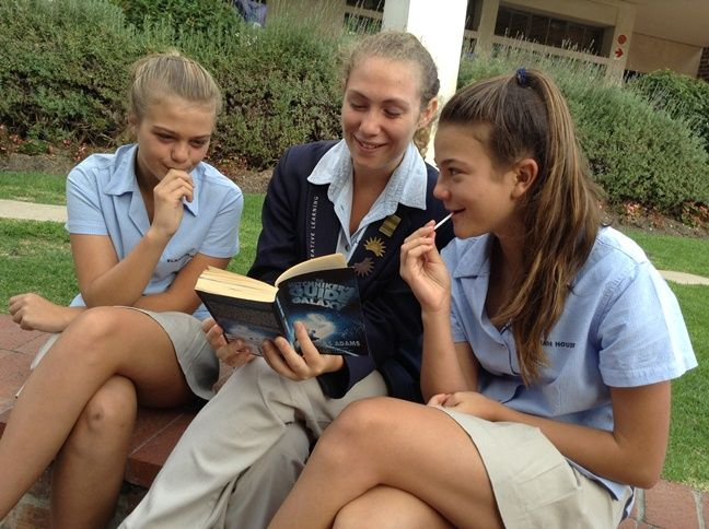 Grade 12 students read pieces from their favourite books to their grade 8 buddies in the Junior High Quad.