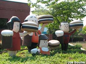 A & W Root Beer Family in Hillsboro. A happy 1960s-vintage outdoor statue display. Mom, Dad, Sis, and Bud all hoist giant burgers and root beer mugs with nuclear family precision.