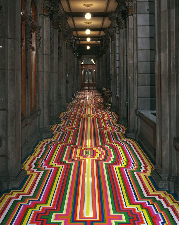 colorful strips of geometric vinyl tape transform room.
