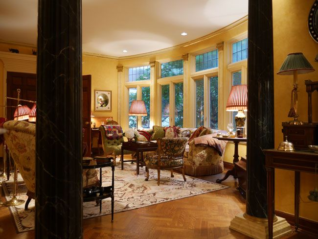 Looking Into The Living Room Of The Nyc Apartment Of Patricia Ulmann Where A Pair Of Faux Marble Doric Columns Divid Faux Marble Nyc Apartment Parquet Flooring