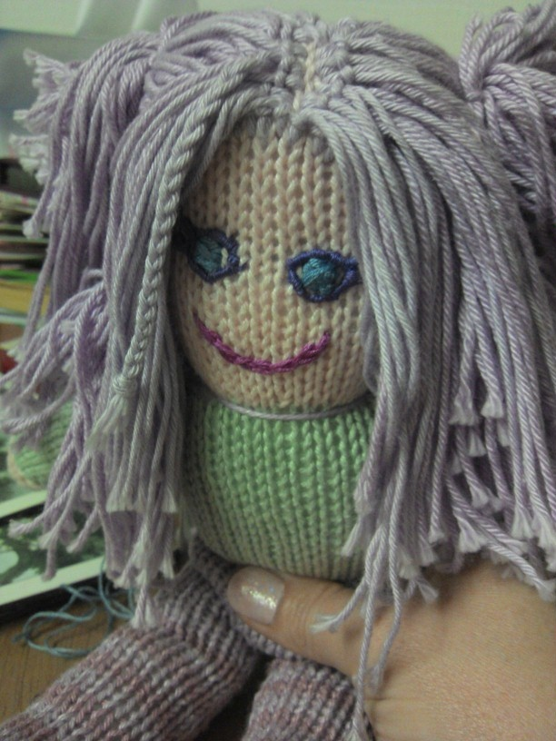 This is my first knitted doll. The eyes still need a bit of work. Took 2 full days during a chill out weekend at Scarborough. She has stripey legs. : )