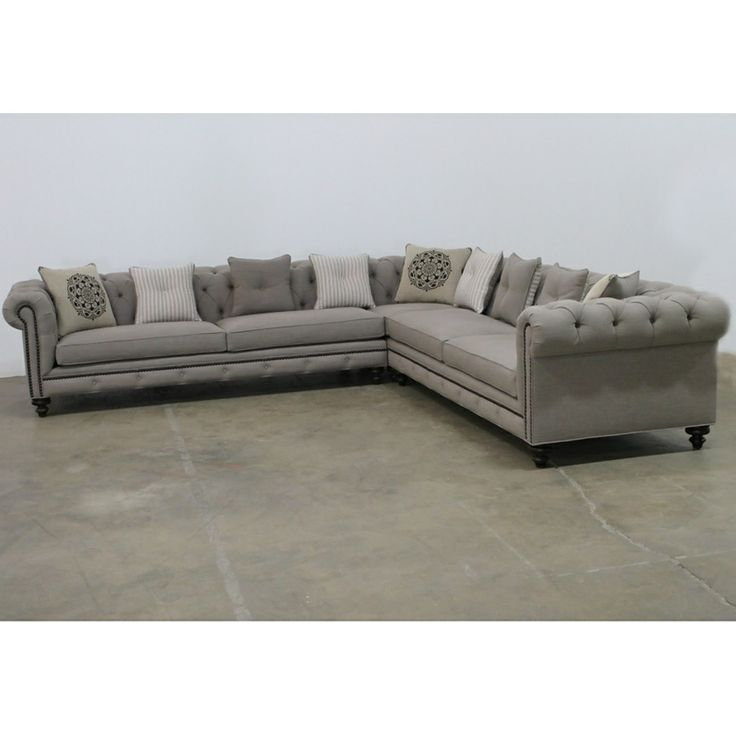 Gray tufted nailhead sofa. reproduction of the classic Chesterfield style, Jar Designs combines a French linen look with old world history. This traditional sectional gets a modern twist using richly textured linen blend fabrics and antique nail-head detailing.