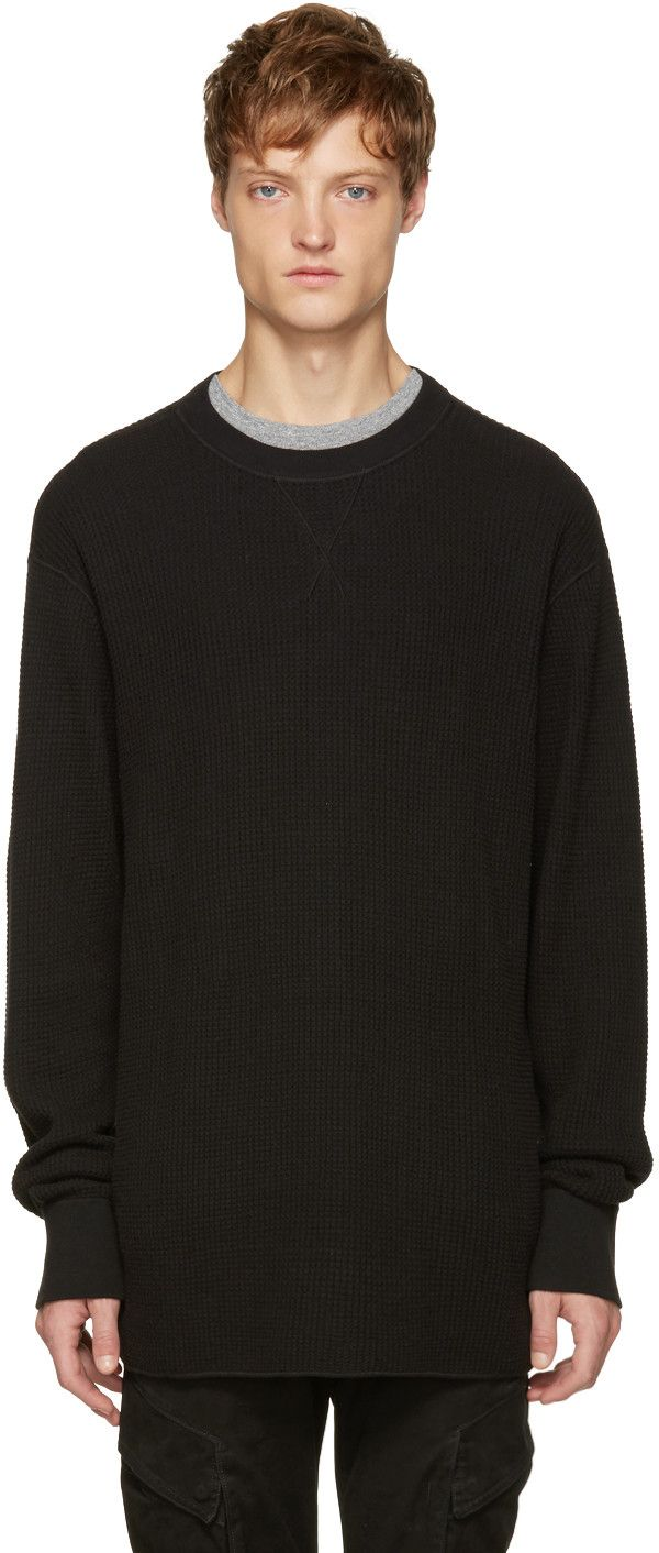 Long sleeve cotton waffle knit t-shirt in black. Rib knit crewneck collar and…