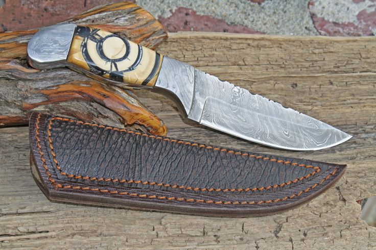 Damascus fixed blade with cross section mammoth tusk ivory fossil