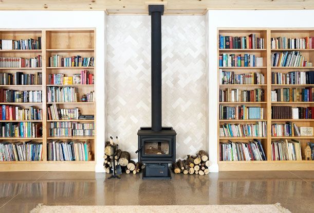 Custom shelving and fireplace surrounds in the Great Room.  Passive Solar Design | Sustainable Building | Solares Architecture