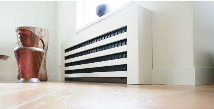 Radiatorombouw-idee voor in de gang. Schilder je 'gewone' radiator in een mooie contrasterende kleur.
