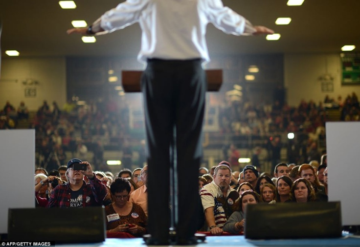 Supporters listen to US Republican Presidential candidate Mitt Romney during a rally in Ohio in October