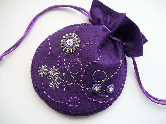 This unique handsewn gift bag or jewelry pouch is made out of purple wool felt. I decorated it with with hand embroidered and beaded