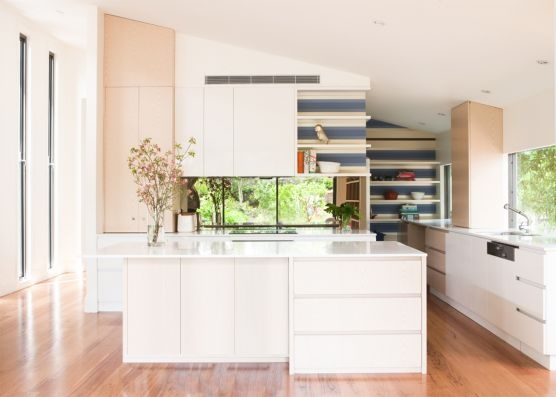 White #kitchen with timber floors