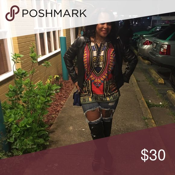 Short sleeve African Dashiki shirt. Multicolor African Dashiki shirt. This shirts says one size but fits like a small. Only wore once perfect condition. Tops Blouses