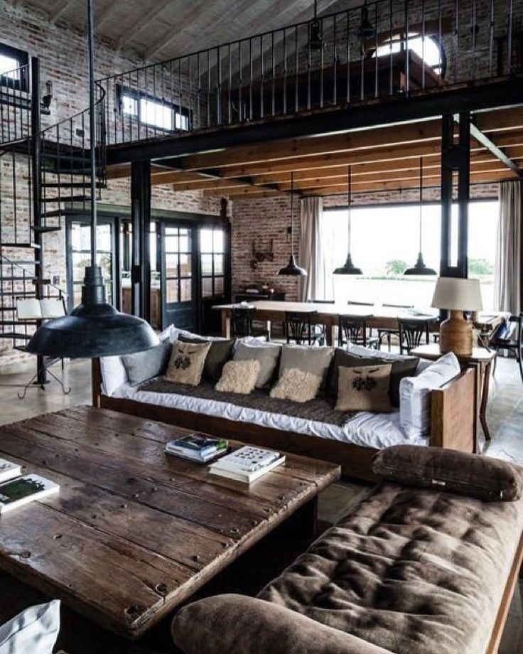 Don't you love the industrial vibe of this cozy home? It's a historic railway shed in Argentina converted into a private residence. Full home tour available on onekindesign.com #inspiration