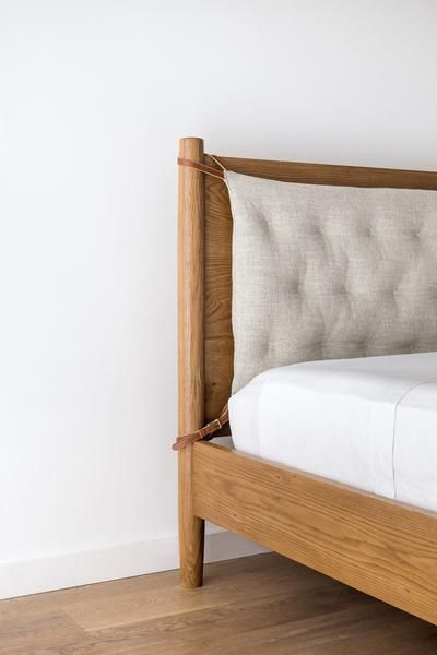"""Solid Oak Bed with upholstered headboard Designed by us Made in LA Dimensions - Queen 86""""Lx 48""""HBoard Height x 16""""Bed Height x 65.5""""W King 86""""L x48""""HBoard Hei"""