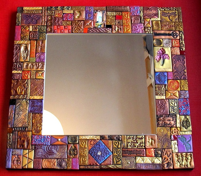 Suerena's mosaics-Titled: Threw the Looking Glass,  Finished Mirror is 15-3/4 inch x 15-3/4 inch,  Mirror glass is 9-3/4 inch x 9-3/4 inch    Materials used are Polymer clay tiles impress with stamps, vintage jewellery and odd bits. Then rubbed with metallic powders, Some tiles done with gold leaf and image transfers and Italian smalti.