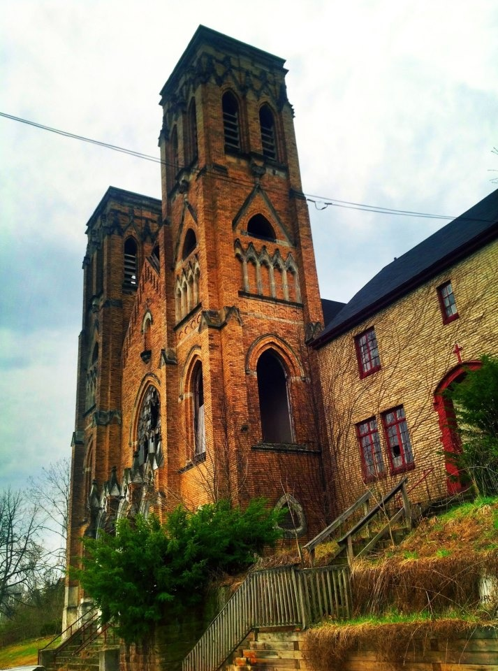 Holy Trinity Catholic Church on S 1st St in Duquesne, PA. The rectory is to the right of the church.