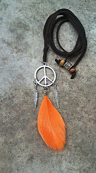 Peace pendant with 2 feather charms and orange feather.  https://www.facebook.com/featherprojectlk/
