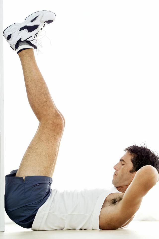 How to do the vertical leg crunch for abdominal strength