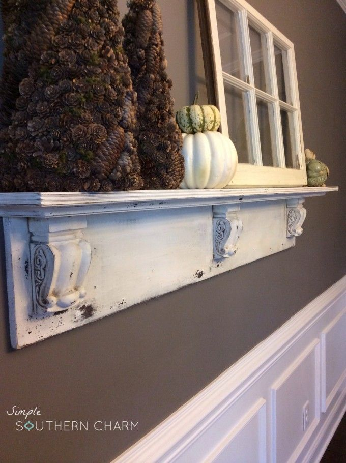Mantel shelf with decorative corbels. You can find similar small corbels for sale online at www.buycarvings.com