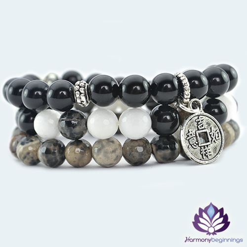 OurPower Gurustretch bracelet stack has been designed with White faceted Jade, Black and Brownfaceted Agate and Black Agate Gemstones. Finished with Tibetan Silver accent beads, Yin-Yang silver bead and Chinese lucky coincharm.  This is a wonderful vibrational combo. The energy in these stones work to integrate the mind and body, releasing the inner power to manifest your full potential.  This design is a stack of 3 individual stretch ...