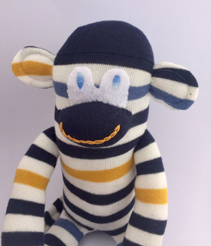 A personal favourite from my Etsy shop https://www.etsy.com/uk/listing/505602132/stripy-blue-sock-monkey-handmade-stuffed