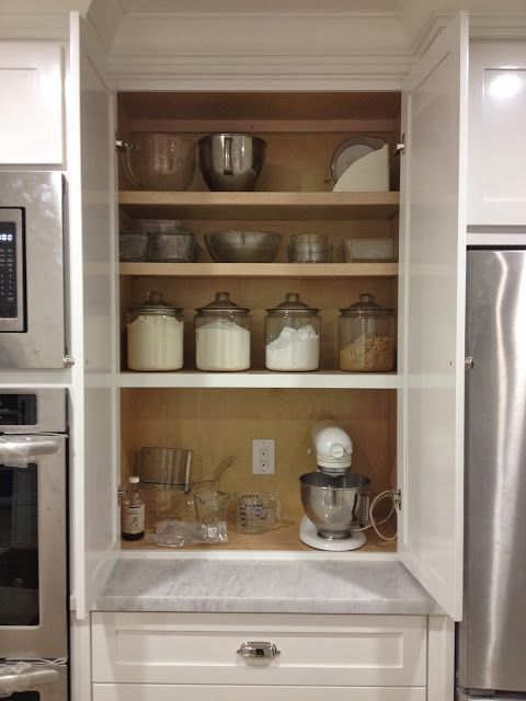 I like this appliance cabinet but I am hoping to have one built that will be deep enough to house the microwave.