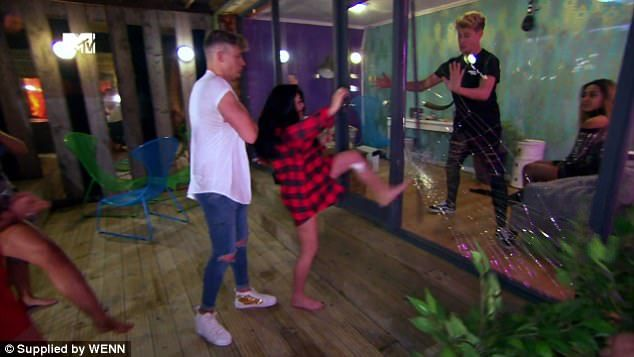Furious:Marnie Simpson has come under fire after smashing a glass door when she became embroiled in an argument on Tuesday night's episode of Geordie Shore