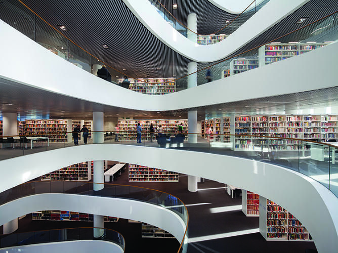 SIR DUNCAN RICE LIBRARY, UNIVERSITY OF ABERDEEN, SCOTLAND In these photos, spines of shelved books appear like ornate mosaics; labyrinthine stacks seem like architectural gestures. The Sir Duncan Rice Library was designed by Schmidt Hammer Lassen Architects, 2012.