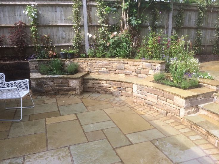 Built in stone bench and raised planters | Landscape Garden Designers ...