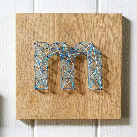 Add a touch of sophistication to your walls with this simple string art project.