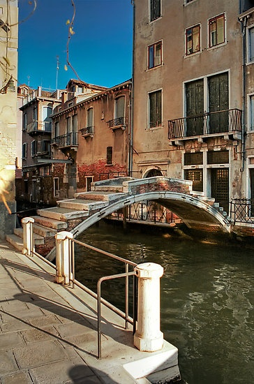 "Ponte dei Pugni (""Bridge of Punches""), between Campo San Barnaba and Campo Santa Margherita. There are no railings on the bridge because in the old days, people used to stage fights there; whoever got thrown into the water first, lost!"