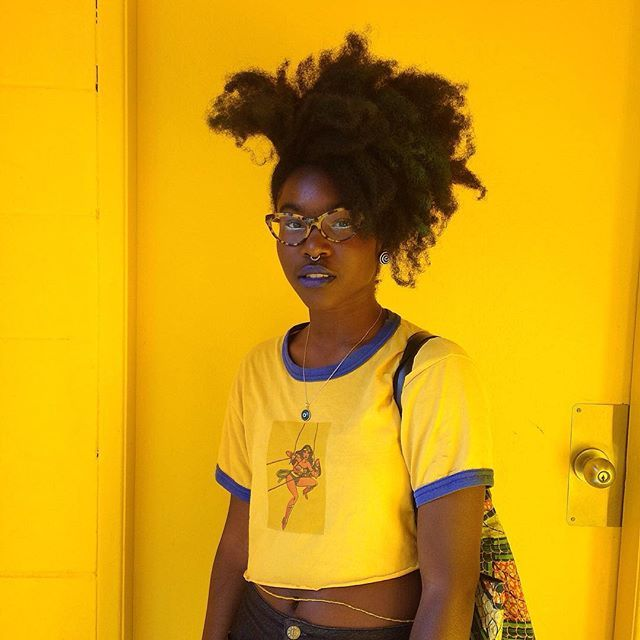 grickgrack:  Yellow walls and afros ✨ Pc: @very.small  by hairuh http://ift.tt/1ITbugd