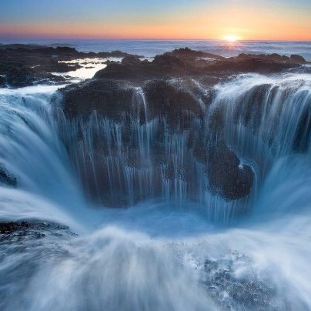 """Thor's Well a/k/a """"the gates of the dungeon"""" on Cape Perpetua, Oregon. At moderate tide and strong surf, flowing water creates a fantastic landscape."""