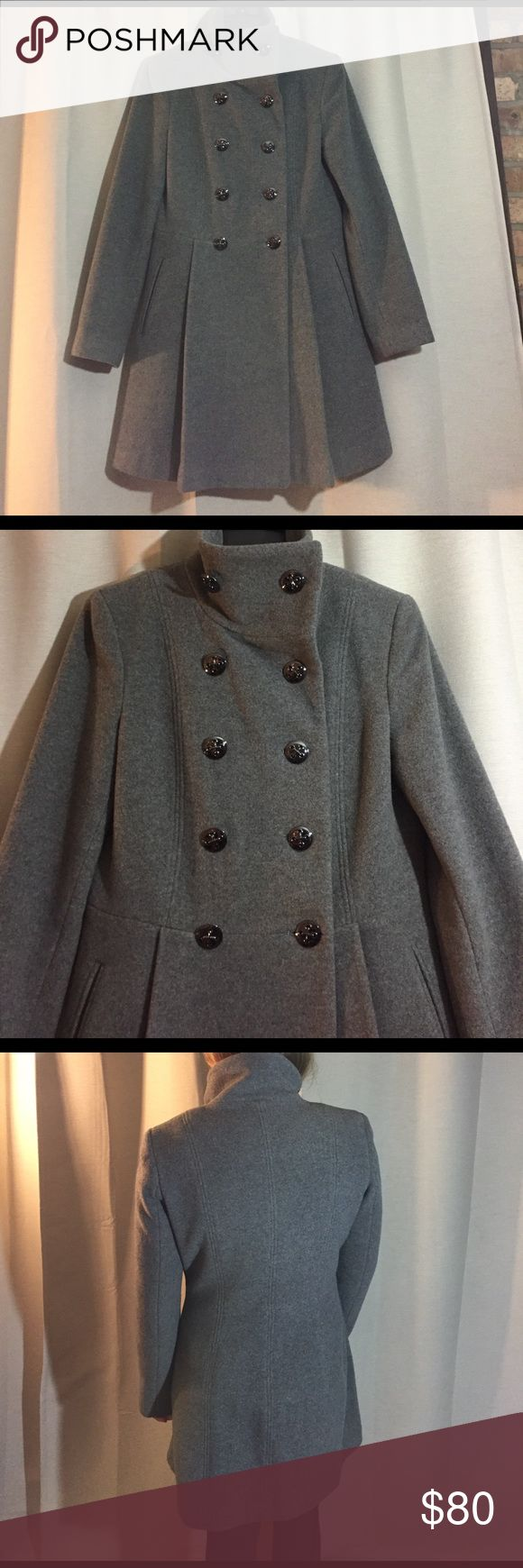 Calvin Klein Grey Pea Coat size 2 great condition Calvin Klein Grey Pea Coat size 2 great condition. Double breasted. Chrome buttons. Model is 5'2 height. Calvin Klein Jackets & Coats Pea Coats
