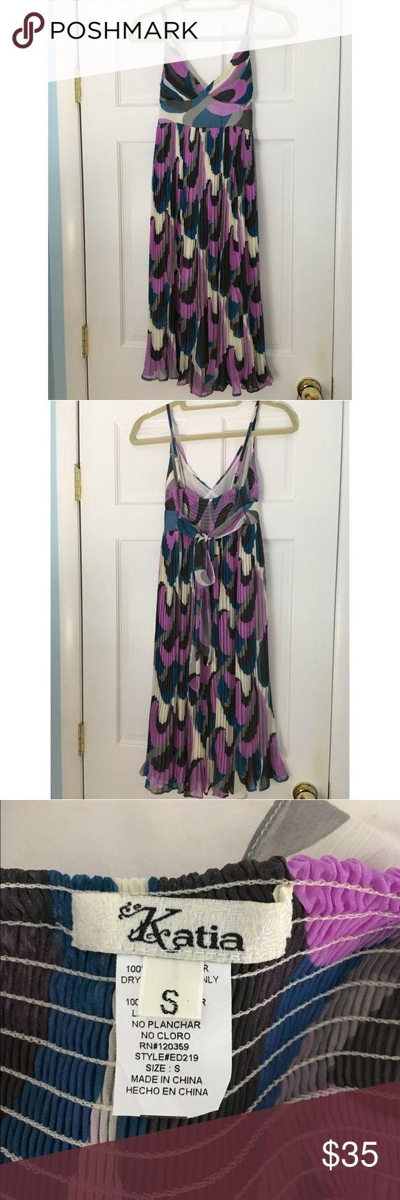 Katia spaghetti strap dress Katia multi-colored spaghetti strap dress. Fitted bodice. Flowy skirt. Ties in back. Worn once for a wedding. Dresses