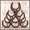 CAST IRON HORSESHOE WINE RACK CAST IRON HORSESHOE WINE RACK.