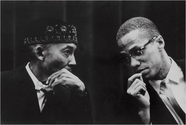 Malcolm and Elijah Muhammad, in a conference. This was before Malcolm discovered Elijah's secret.